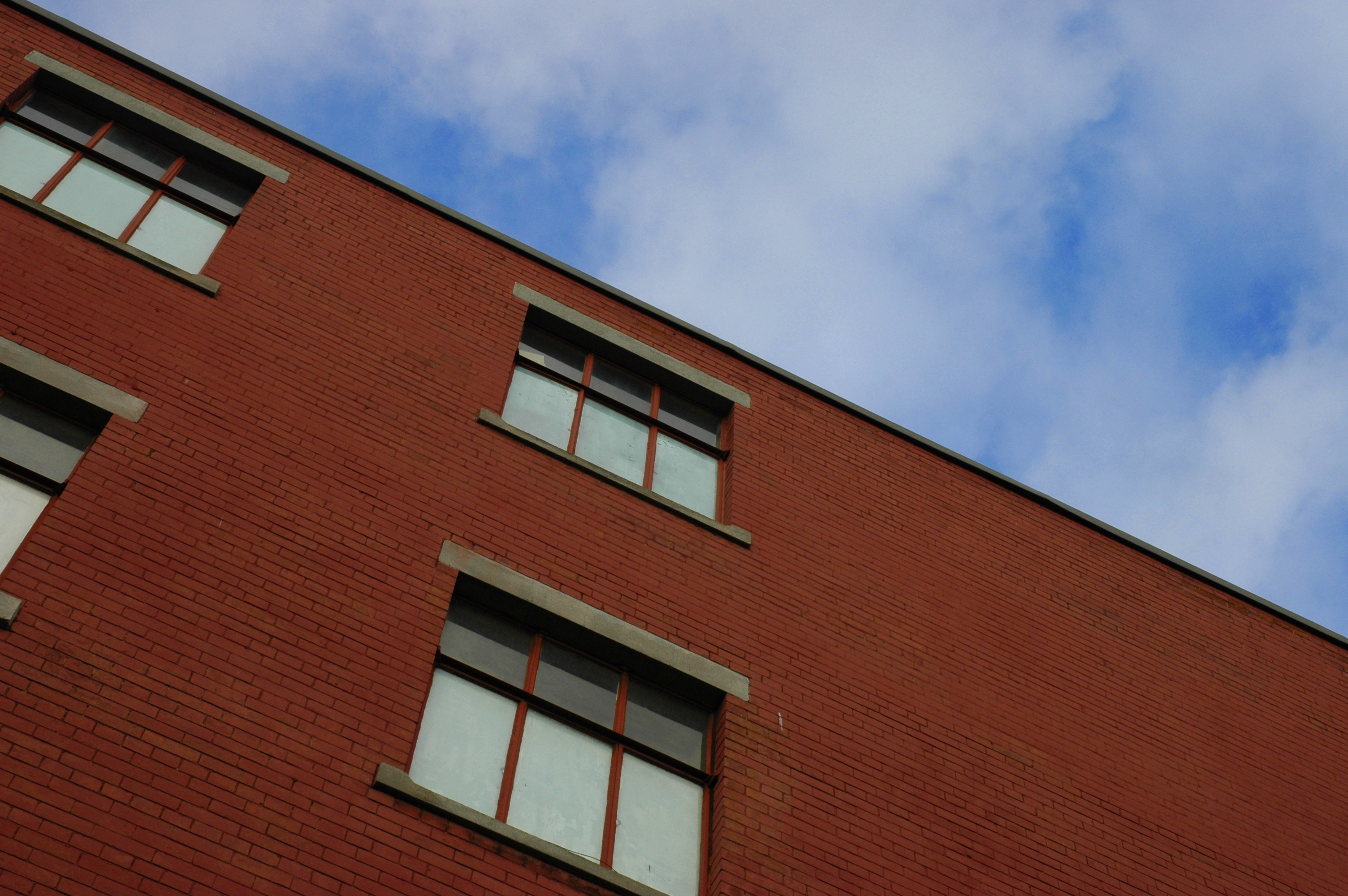 red brick building with blue sky